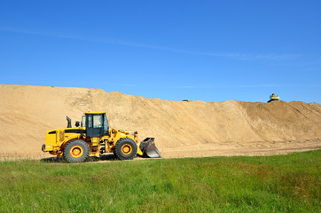 bulldozer working in sand dunes