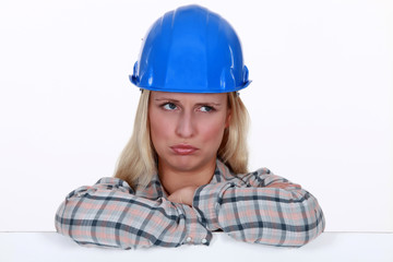 Sad female builder