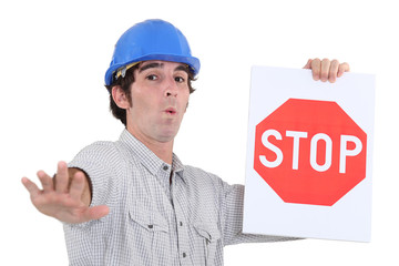 Worker holding a red stop sign