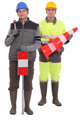 Two road workers stood together