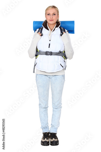 Studio portrait of a female backpacker