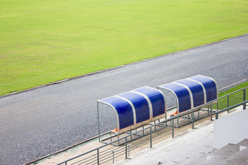 Coach and reserve benches in football stadium.