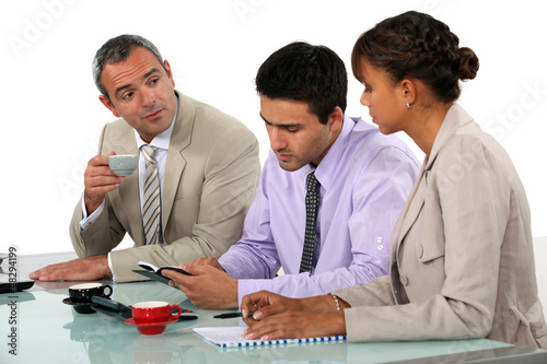 Three people sat on interview panel