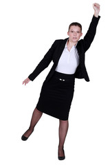 Businesswoman reaching into the air
