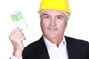 Architect holding bank note