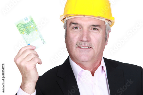 Architect holding bank note