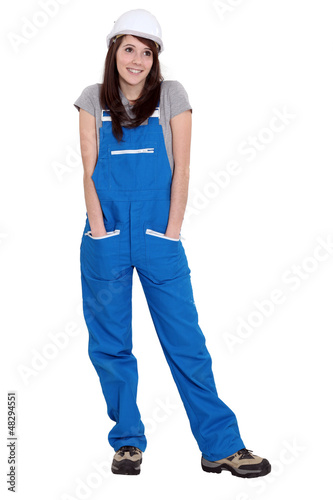A cute brunette in her overalls.