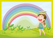 A smiling girl and a rainbow