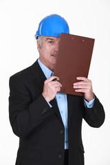 Man with portfolios covering hir eye