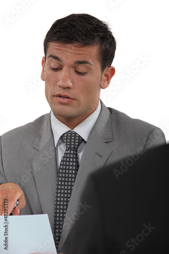 Businessman talking about a document in a meeting