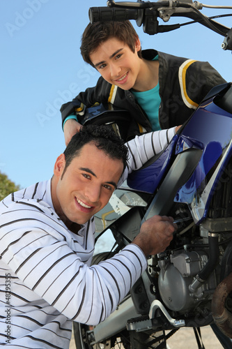Father and son with a motorbike