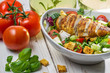Healthy salad with chicken and tomato