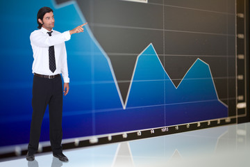 tall dark-haired man standing before graph