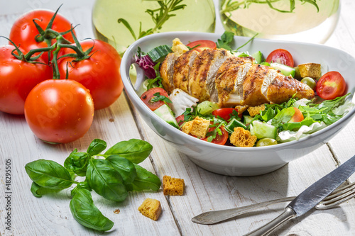 Caesar Salad with chicken and fresh ingredients