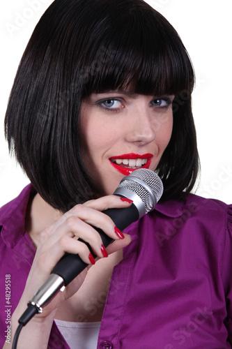 Pretty girl singer on white background