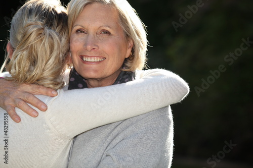 Woman hugging her granddaughter