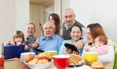 Happy family  with electronic devices