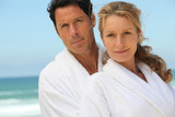 Middle-aged couple in bathrobe