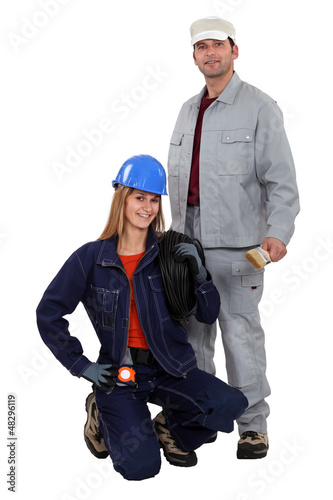 Electrician kneeling by painter