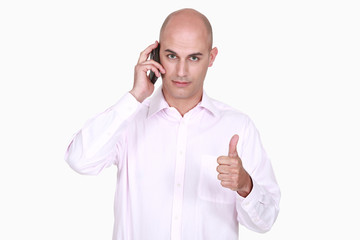 Man talking on the phone and giving the thumb's up
