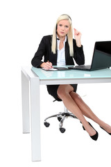 Businesswoman using a telephone headset