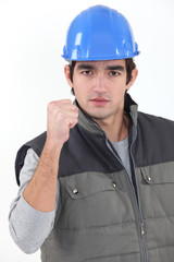 Builder pumping fist in delight