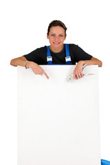 Female electrician pointing at blank board