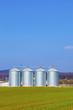 silver silos in field