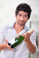 Man with bottle of champagne