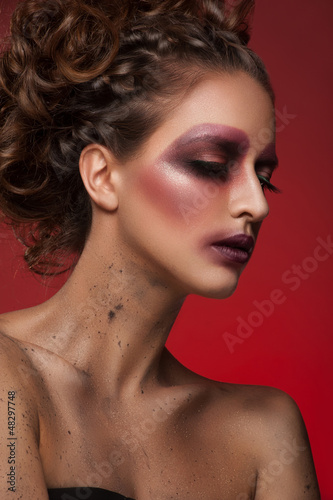 Woman with creative bright makeup