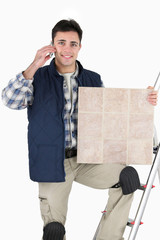 Tiler answering phone call from customer