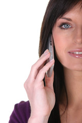 Closeup of a woman with a phone