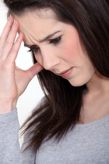 close-up picture of young woman having migraine