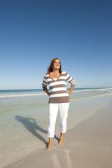 Beautiful mature woman beach holiday retirement