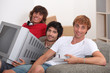 Three young men moving into to new house