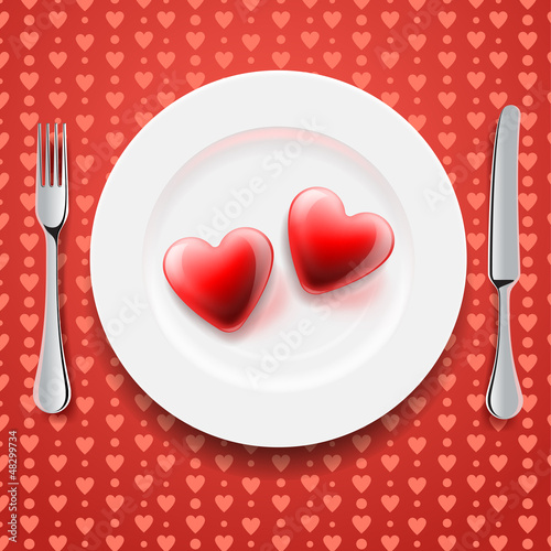 Red hearts on a plate, knife and fork, vector Eps10 image