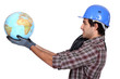 Laborer holding a globe