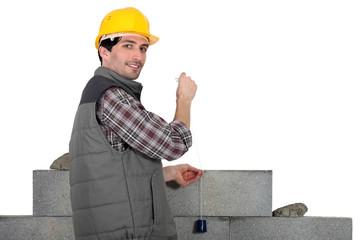 mason building a wall