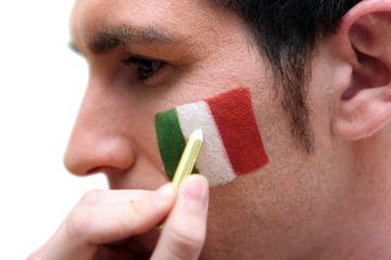 Man having the Italian flag painted on his cheek