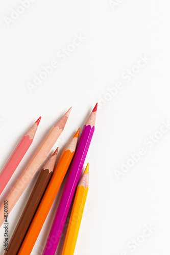 Colorful wooden pencils on a sheet
