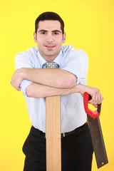 Businessman  with hand-saw