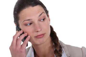 woman with cell phone looking puzzled