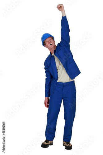 Manual worker raised clenched fist in the air