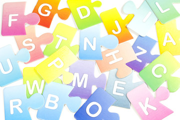 Abstract colorful background with puzzle letters