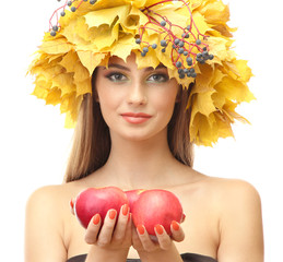 beautiful young woman with yellow autumn wreath and apples,