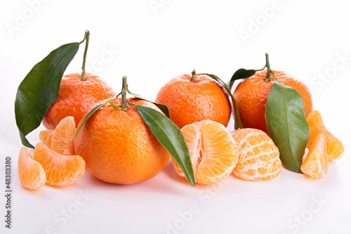 Ripe sweet tangerine isolated on white