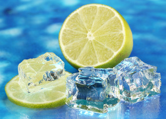 Ice cubes with lime on blue background