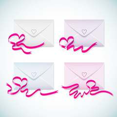 Set of gift cards with red heart ribbon.