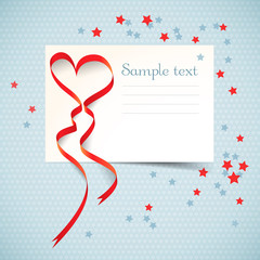 Gift card with red heart ribbon.