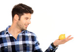 young man holding a lemon